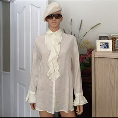 """💐 NWOT...FERAUD 100% linen ruffled  blouse NWOT...PRICE FIRM: Designer Louis Feraud .. 100% of the finest linen.. Ivory color...with a ruffle down the front, ruffle on the cuffs, and dainty buttons to finish off this feminine blouse, top to bottom 30"""", collar to cuff 31"""", chest 23"""", shoulder to shoulder 19"""", pls see photos, excellent condition, no trade, no pp, smoke and pet free environment Feraud Tops Blouses"""