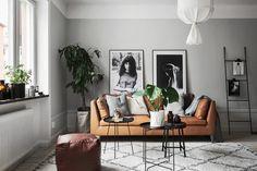 Grey walls, tan sofa and large artwork