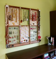 A large paned window would give a lot of space for jewelry. I like how you could use a different pane for necklaces, bangles, or earrings. I might just do burlap and no knobs in the corners for simplicity.  I have space for this in our master, but no old window.~kss