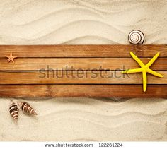 Few marine items on a wooden boards against sandy background. #stockphoto #seashells #seastar #summer #shutterstock
