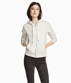 Light gray melange. Sweatshirt jacket with a lined hood with extra-wide drawstring. Zip and pockets at front and ribbing at cuffs and hem. Soft, brushed