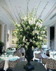 FOYER: large entry table arrangement of lilies...