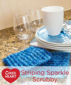 Striping Sparkle Scrubby Free Knitting Pattern in Red Heart Yarns -- Two shades of blue are combined for easy-to-knit scrubbies to help clean up the after dinner mess. You'll love the ease of knitting with Scrubby Sparkle and how nicely you can keep them fresh by machine washing.