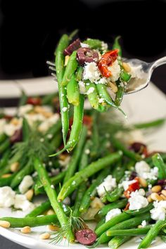 Perfectly pair this delicious Greek Green Beans recipe with any of your summertime favorite entrees. This simple side dish recipe is made with kalamata olives, feta cheese, Diamond® pine nuts and sundried tomatoes.