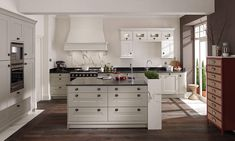Second Nature has just launched a new product, Fitzroy.  It is a classic shaker style shown here in a mix of porcelain and stone - http://www.sncollection.co.uk/kitchens/fitzroy.html