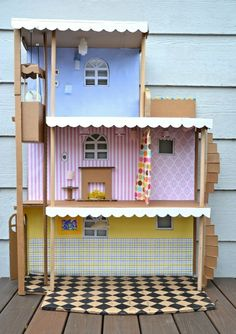 ikat bag: Cardboard Barbie House, with working elevator and lights! Cardboard Dollhouse, Cardboard Toys, Diy Dollhouse, Homemade Dollhouse, Cardboard Playhouse, Cardboard Castle, Cardboard Kitchen, Cardboard Houses, Cardboard Design