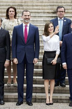 4 May 2017 - King Felipe and Queen Letizia visit National Library in Madrid - blouse and clutch by Hugo Boss