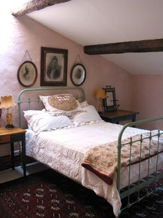 Love the way the pictures are hung above the bed.  My parents and grandparents? ** this is how i envision one of the tinr second floor bedrooms for my ex if he visits or ends up retiring and moving in.