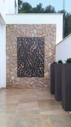 Laser cut screen - Majorca Spain -  Frond design by Miles and Lincoln. www.milesandlincoln.com