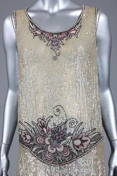 ~1920s Haute couture evening dress circa from French in 1928. A vintage sequined and beaded flapper dress made from the tulle ground covered in irridescent sequins, flower floral bead panels in shades of pink green color at the neckline, dropped waist and hem~