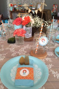 Teal and orange place settings at a Brave birthday party! See more party ideas at CatchMyParty.com!