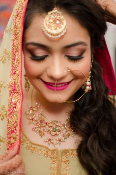 Looking for Bride Wearing Maangtikka Nath and Stone Work Necklace? Browse of latest bridal photos, lehenga & jewelry designs, decor ideas, etc. on WedMeGood Gallery. Nose Ring Jewelry, Indian Nose Ring, Hot Pink Lips, Pink Eye Makeup, Asian Bride, Bride Indian, Indian Bridal Makeup, Bride Portrait, Indian Wedding Photography