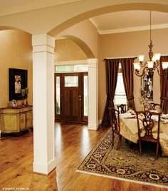 Plan #933 - The Yankton. The foyer and dining room are sectioned off with arches and columns. http://www.dongardner.com/plan_details.aspx?pid=2530. #Foyer #Column #Dining