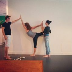 #yogastory Day 10: Zefea and Toddy help Natalie kick higher in Standing Bow.  Get higher: www.evolationyoga.com/teach  #yoga #hotyoga #yogateacher #yogateachertraining #learn #love #yogapants