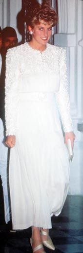 Designed by Catherine Walker. White lace coat dress decorated with pale blue flowers and white sequins. Diana wore this coat dress during an official visit to France in 1988 and again in 1989 for a visit to the Royal Opera House. $27,600.00 Purchased by Barbara O'Neill of Rome Georgia.