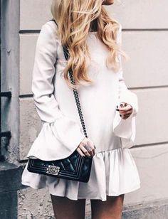 Flutter sleeve drop-hem dress. Click through to shop a similar find!