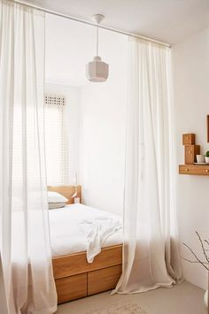 Add a bit of privacy to a nook bed with a breezy curtain