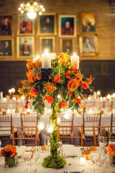 over the top orange floral arrangement by Flowerful Events