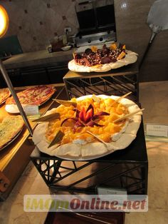 Here's something different - Sweet pizzas at Escolta, #ThePeninsulaManila. Mango Graham Pizza and Chocolate Peanut Butter Cheesecake Pizza - luscious!