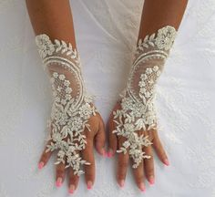 White/ ivory bridal lace gloves made of floral lace with by ATUFA on Esty FOUND EM!