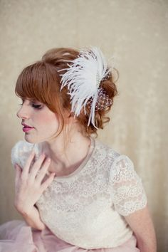 Bridal Feather Fascinator, birdcage veil, bridal headpiece, Zoey Ships in 1 Month. $145.00, via Etsy.