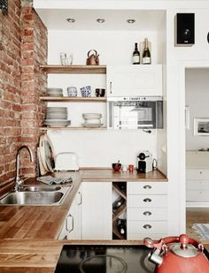8 Smart Ways to Organize a Small Kitchen - DITCH WHAT YOU DON'T NEED Seems obvious, right? But how many spatulas (and good heavens, mugs) does one woman really need? Keep the essentials and donate the doubles or items you know--in your heart of hearts--you're never going to use.