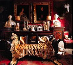 A tiger skin...  I believe this is a required item for a man cave.  Tim Knox's home in London. Photo: World of Interiors.