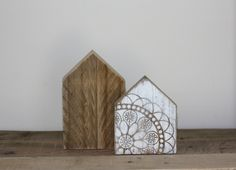 Two little wooden houses, made from reclaimed timber Sizes 16cm high by 10cm wide  and 12cm high by 9.5cm wide Freestanding