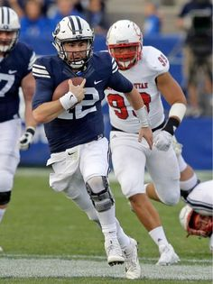 FILE – This Nov. file photo, shows BYU quarterback Tanner Mangum, left, carrying the ball as he is pursued by Southern Utah defensive lineman Sione Fukofuka in … College Football Games, Ncaa College Football, Byu Sports, Lineman, Football Helmets, Two By Two, Seasons, Wyoming, Events