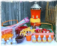 A snack table for a backyard movie night. Let the kids help themselves to treats and drinks.