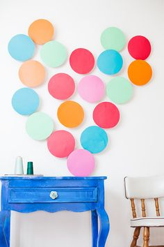 DIY confetti heart on the wall.