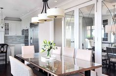 Google Image Result for http://cdn.decoist.com/wp-content/uploads/2012/07/white-themed-dining-room-with-modern-hanging-lamp.jpg