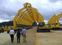 Komatsu excavators lined up ~ http://www.machineryzone.com/