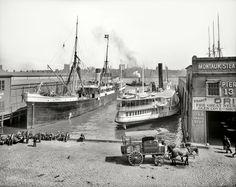"New York circa 1905. ""Piers at foot of Wall Street. Steamship Curityba and sidewheeler Nantasket."""