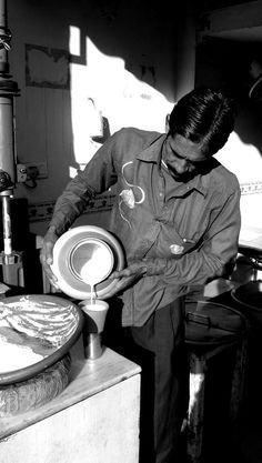 Pouring a lassi drink in Jaipur, India (Jan 2013) - Picture taken by BradJill