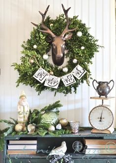 "It doesn't get much more country than a faux stag's head surrounded by vintage ephemera. A ""Noel"" banner and a few simple ornaments dresses up this Stag Head Boxwood Wreath for Christmas. Christmas Feeling, Christmas Porch, Merry Little Christmas, Noel Christmas, Christmas Is Coming, Rustic Christmas, Winter Christmas, Vintage Christmas, Christmas Wreaths"