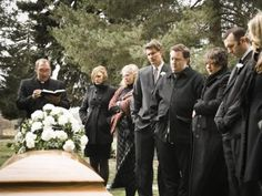 people at a funeral - RubberBall Productions/Vetta/Getty Images