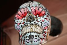 Day of the Dead sugar skulls decorated by tattoo artists.