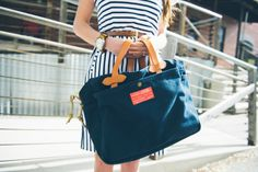 striped dress with filson canvas tote | spring outfit idea + real-girl fashion