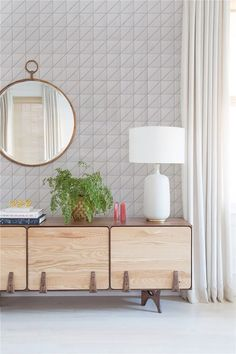 Pure white living room decoration, finished with white geometric tiled wall design. #homedecor #interiordesign