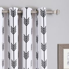 Give your home decor a dose of modern style and whimsy with this pair of arrow room darkening blackout grommet curtain panels. The curtains come with tiebacks, allowing you to easily pull back the cur