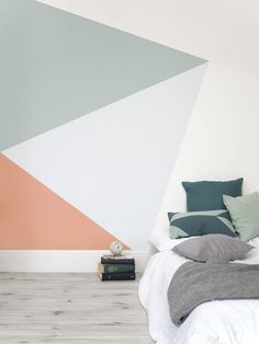 Daydream under dazzling geometrics. This geometric wallpaper design combines delicate colours with elegant lines, giving your interiors a fresh take on the usual geometric patterns. Ideal for modern bedroom spaces.