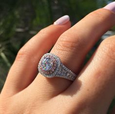 This Gabriel & Co. engagement ring features 0.36ctw round brilliant diamonds, 0.45ctw princess cut diamonds, and 0.17ctw pink diamonds, that together creates a stunning masterpiece that is your engagement ring