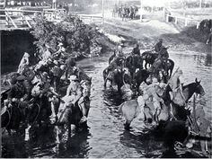 Troops watering horses in the Avon River near Carlton Bridge, Christchurch  [23 Sept. 1914] Anzac Day. New Zealand