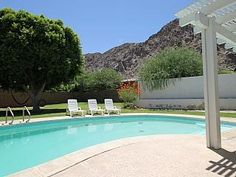 You've found your Happy Place! Relax in the sparkling swimming pool, enjoy a lively game of pool with friends, or unwind in the hammock beneath a mature shade tree while the sun dips behind the dramatic mountain backdrop. Conveniently located to all Coachella Valley events and entertainment, this home is also walkable to La Quinta restaurants, banking and shopping. Why drive when all you need is within your own backyard or just outside your front door. This fun family retreat allows you and…