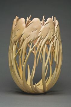 The intricacy of this wood sculpture of perched birds is stunning. Dreamscape, 2008, by Ron Layport; Tulip Poplar wood, Pigment