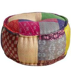 "Ikat Sari Pouf  $139.95    Looking for unconventional seating that's both cute and colorful? Pouf! It's here. Our Ikat Sari Pouf to be exact. Featuring patchwork inspired by the vibrant fabrics and patterns found in traditional Indian saris, this unique, eye-catching piece doubles as comfy seating.     Color: Multi  Size: 24""Dia x 12""H  Spot clean only"