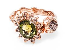 e.g.etal - Elizabeth ring, Julia deVille i think this ring is so beautiful and unique with the arraignment of the stones and the shape of the band