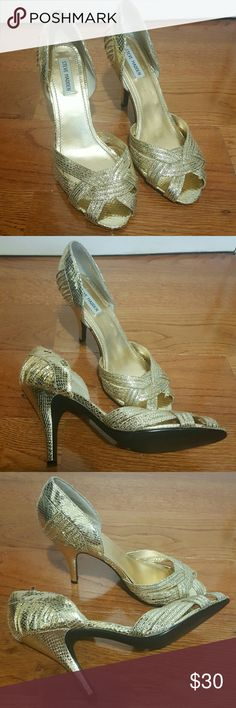 S M Treason heels They are store display shoes. Gold sparkly heels in excellent condition. 4 inches heel.. no orignal box.. Steve Madden Shoes Heels