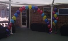 Cute colourful string of pearl arch and floor arrangements for home birthday party. Turns the backyard into a great party vibe!
